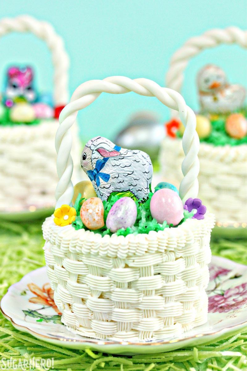 Easter Basket Cupcakes - A single cupcake displayed decorated as a basket filled with candy. | From SugarHero.com