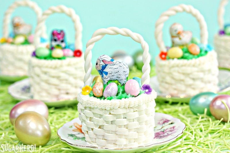Easter Basket Cupcakes - Multiple cupcakes displayed with candy inside. | From SugarHero.com