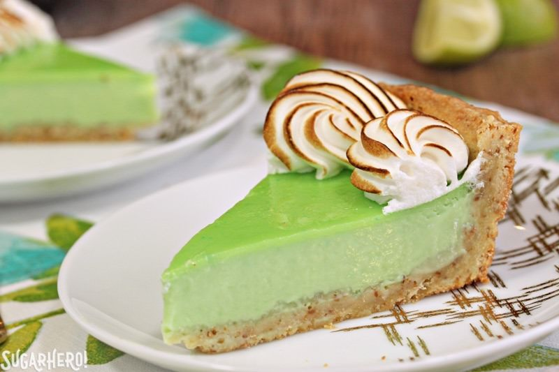 Toasted Coconut Lime Meringue Tart - with a tangy lime filling and toasted meringue on top! | From SugarHero.com