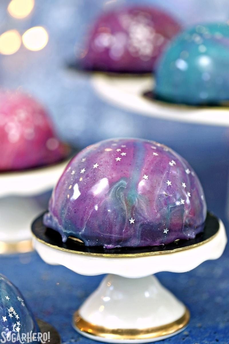 Galaxy Mousse Cakes - A close up shot of a mini mousse cake. | From SugarHero.com