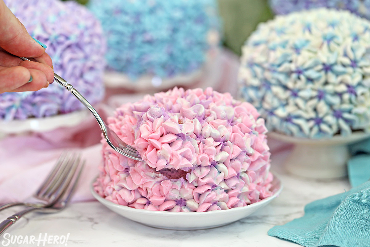 Hydrangea Cakes - A close up shot of a bite being take out of a cake. | From SugarHero.com