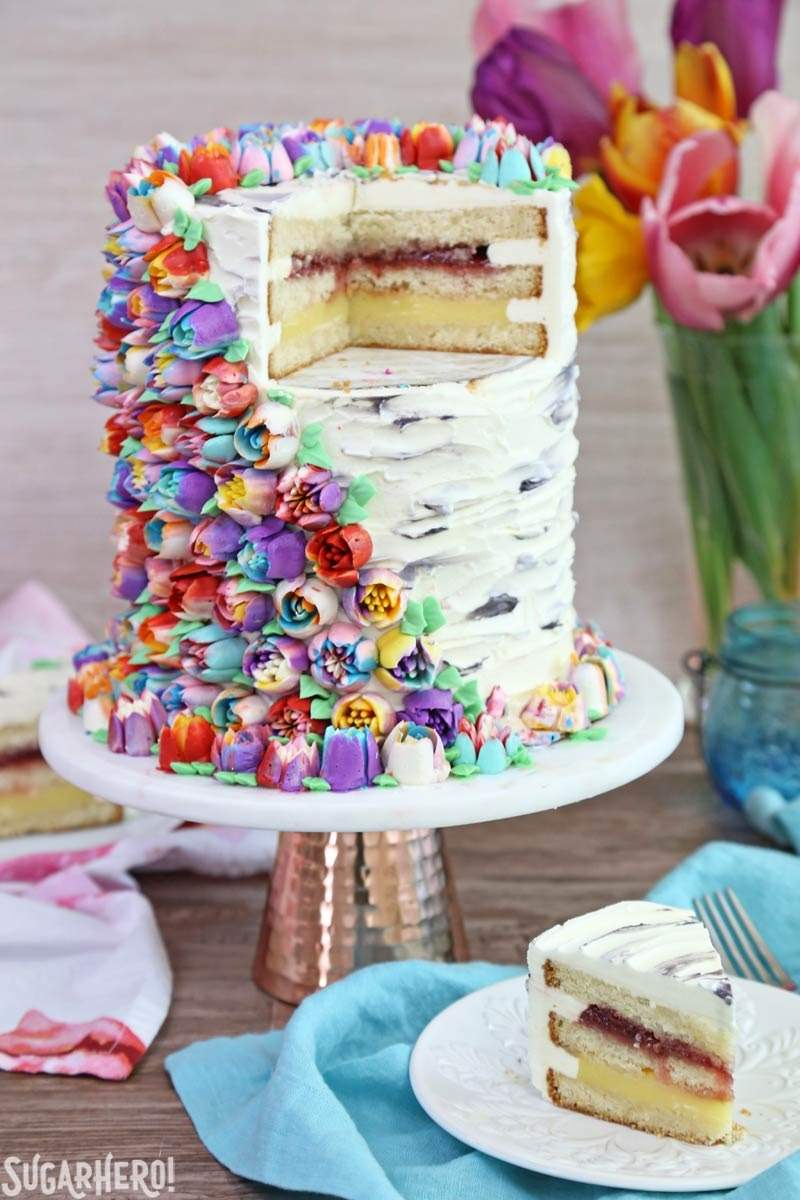 Spring In Bloom Layer Cake - an extra-tall cake covered in Russian Piping Tip flowers | From SugarHero.com