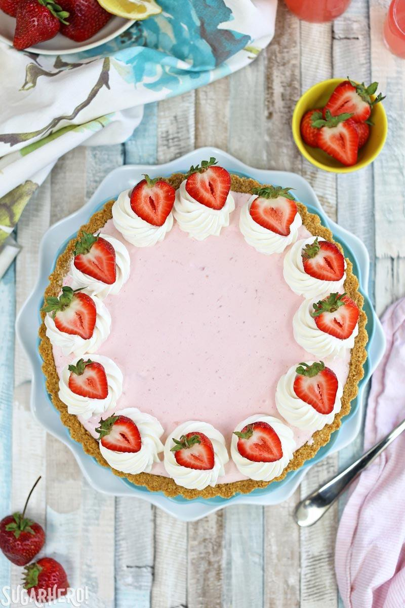 Strawberry Lemonade Ice Cream Pie - an easy and refreshing ice cream pie in a graham cracker crust! | From SugarHero.com