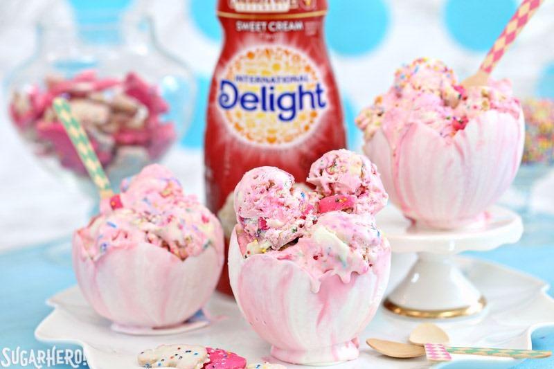 Circus Animal No-Churn Ice Cream - pink and white swirled ice cream in edible white chocolate bowls!   From SugarHero.com