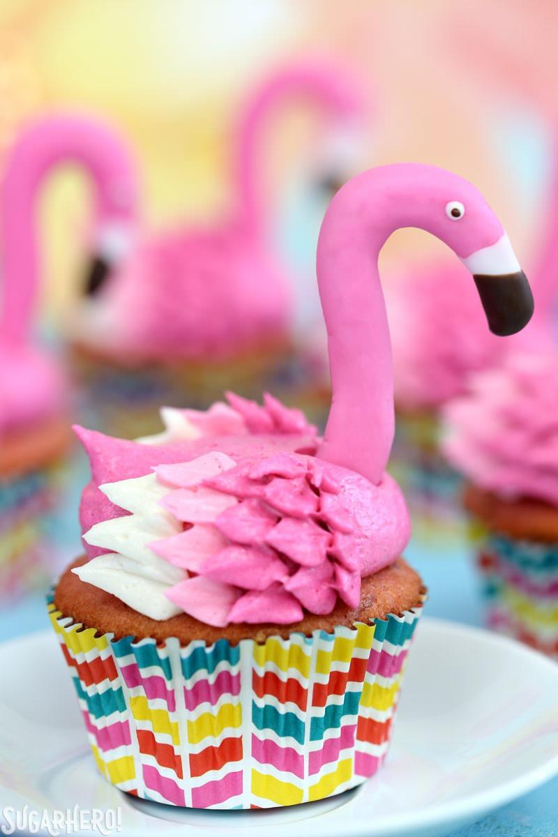 Close-Up of Pink Lemonade Flamingo Cupcakes with Fondant Flamingo Heads | From SugarHero.com