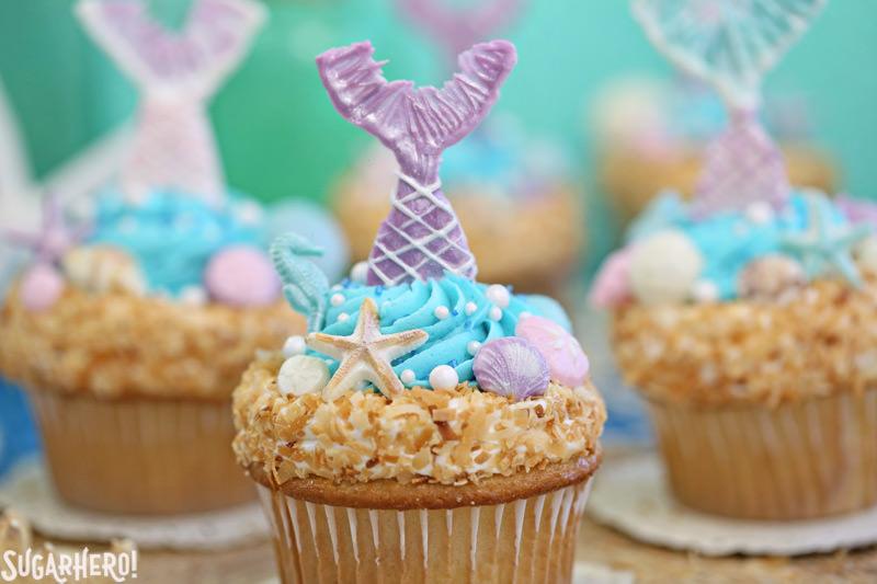 Mermaid Cupcakes - close-up of mermaid cupcake with purple chocolate mermaid tail   From SugarHero.com