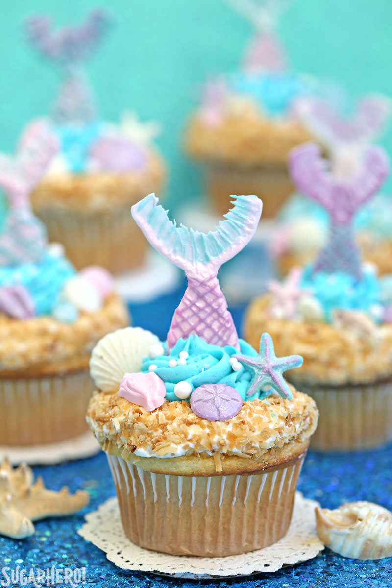 Mermaid Cupcakes - gorgeous under-the-sea cupcakes with edible mermaid tails and chocolate seashells!   From SugarHero.com