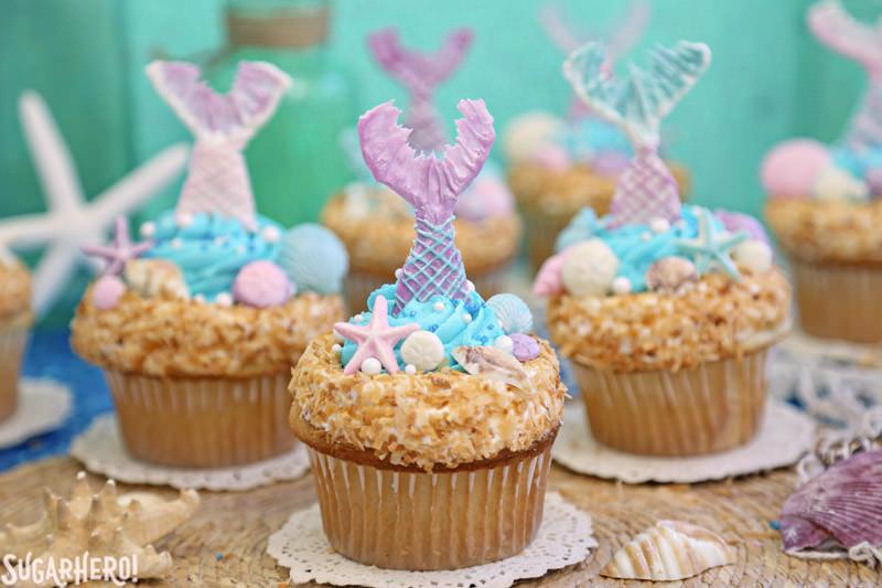Mermaid Cupcakes - a grouping of gorgeous mermaid cupcakes, with chocolate mermaid tails   From SugarHero.com