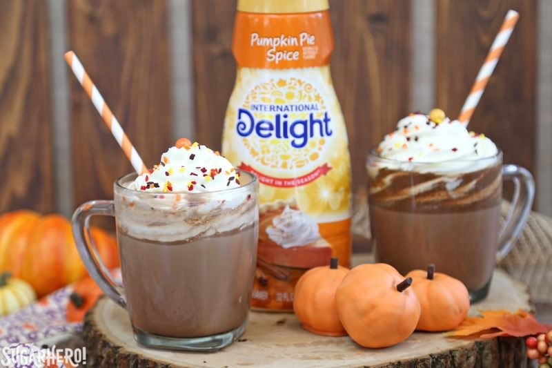Pumpkin Spice Hot Chocolate Truffles - mug of pumpkin spice hot chocolate next to International Delight pumpkin spice creamer | From SugarHero.com