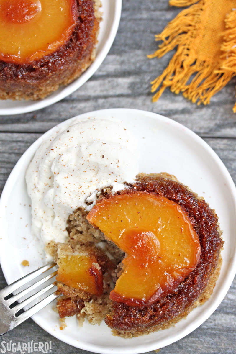Peach Upside-Down Cakes with a bite taken out of it | From SugarHero.com