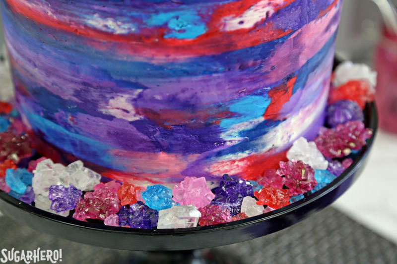 Agate Cake - close-up of the buttercream effect on the sides of the agate cake, and the rock candy that decorates the base | From SugarHero.com