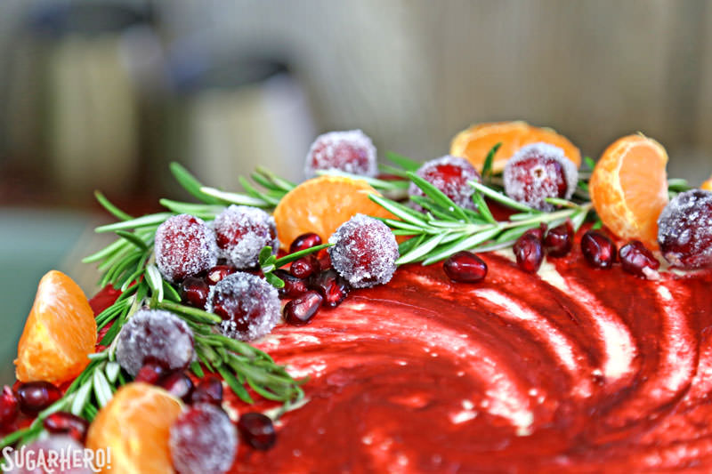 Brown Sugar Cranberry Cake - close-up of top of cake featuring fresh fruit and rosemary | From SugarHero.com