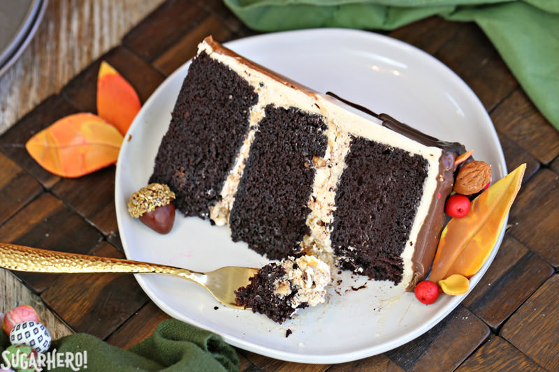 Festive Fall Layer Cake – single slice of cake with bite on fork | From SugarHero.com