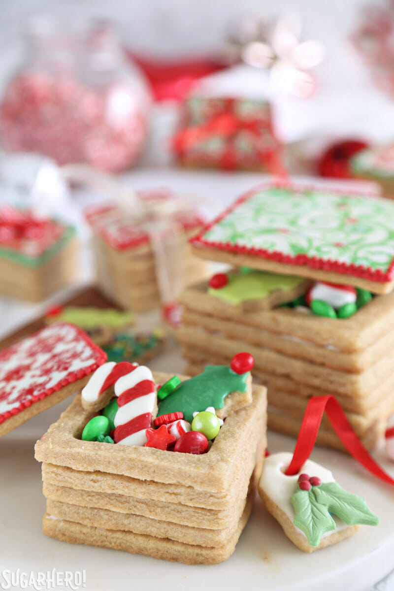 Christmas Present Cookie Boxes - cookie box with treats inside and top leaning on the side of the box | From SugarHero.com