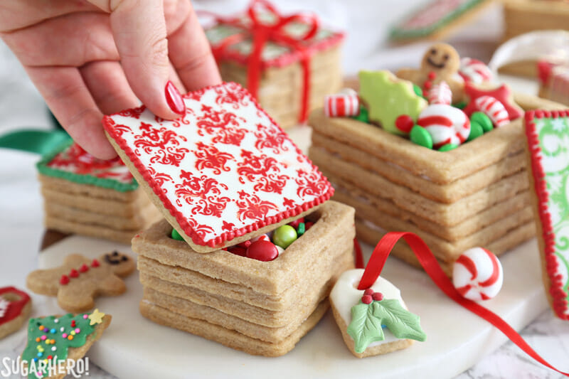 Christmas Present Cookie Boxes - putting a cookie lid on the box | From SugarHero.com