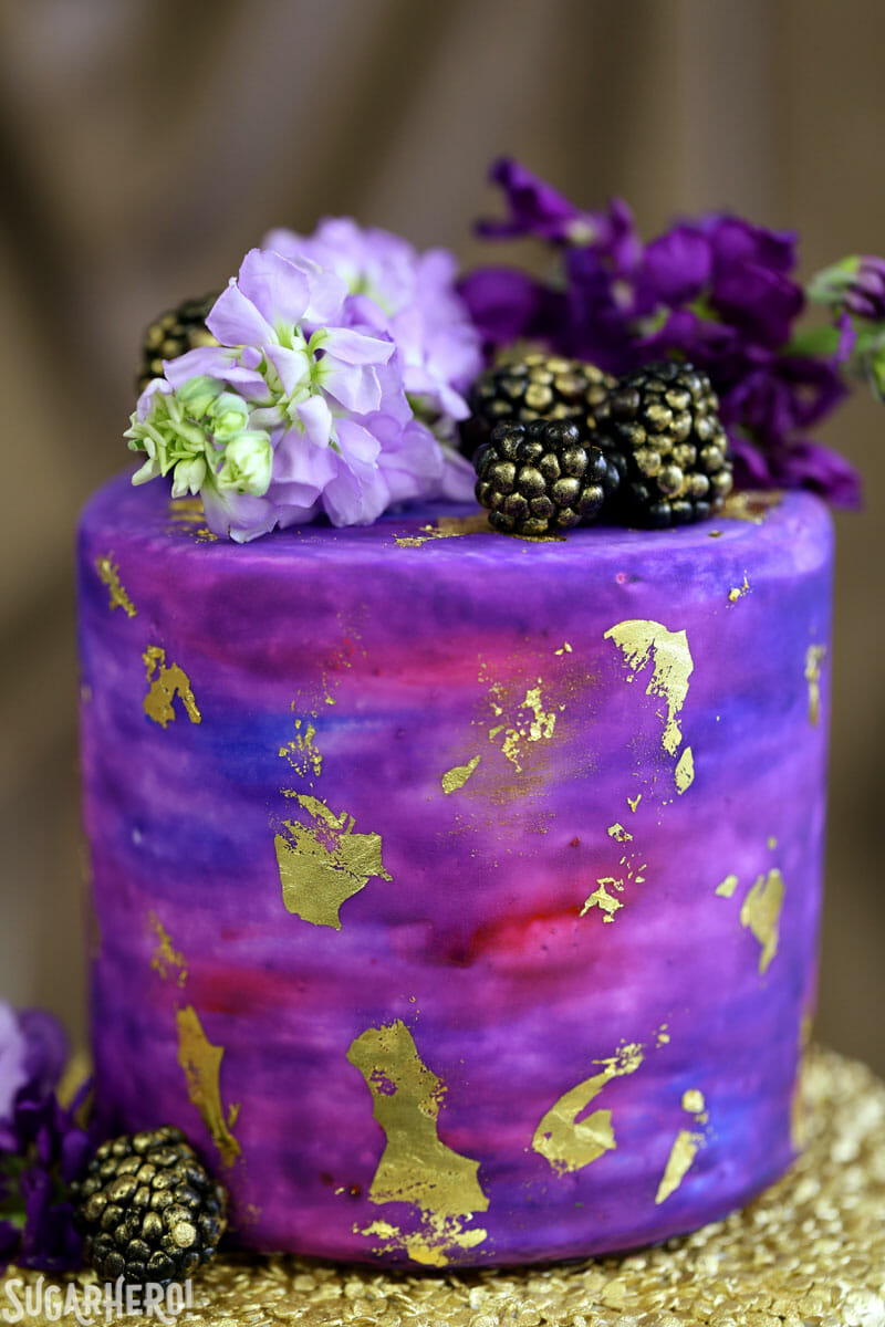 Gold Sequin Watercolor Cake - close-up of watercolor cake layer | From SugarHero.com