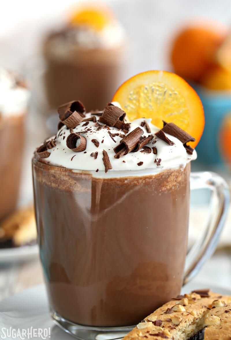 Orange Hot Chocolate with whipped cream and chocolate curls on top   From SugarHero.com