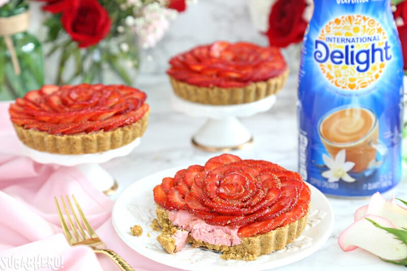 Strawberry Rose Tarts - three tarts, with bites taken out of one tart | From SugarHero.com