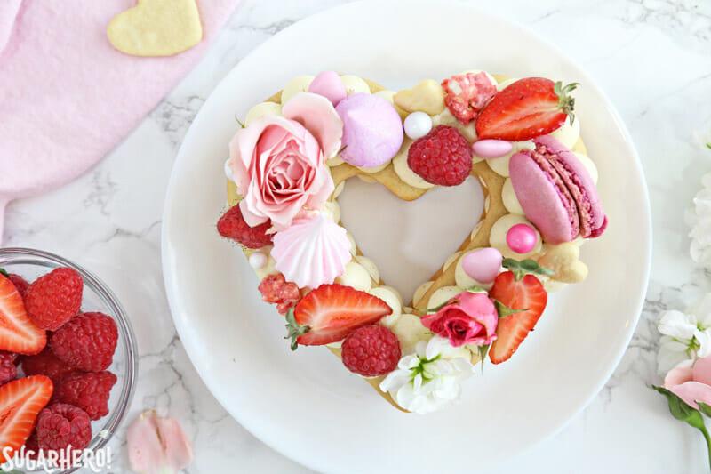 Trendy Cream Tarts - overhead shot of a single heart-shaped cream biscuit | From SugarHero.com