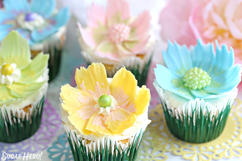 Easy Chocolate Flower Cupcakes - lemon-coconut cupcakes with edible chocolate flowers on top | From SugarHero.com