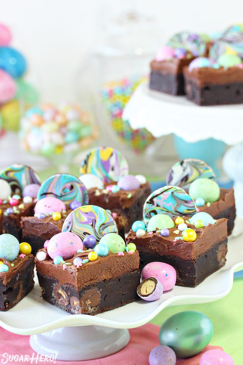 Malted Milk Chocolate Brownies - brownies on a cake stand | From SugarHero.com