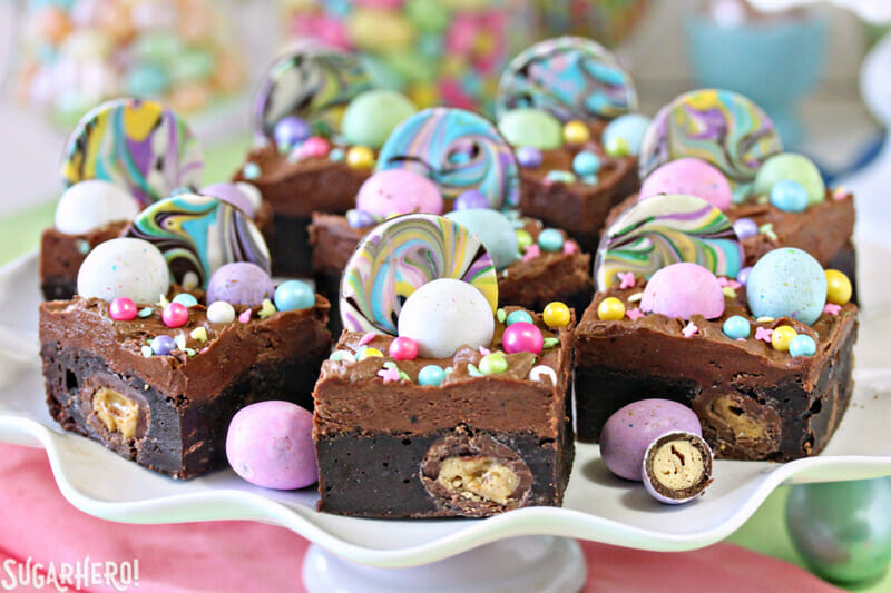 Malted Milk Chocolate Brownies - group of colorful brownies on a cake stand | From SugarHero.com