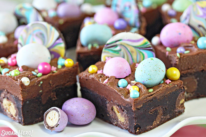 Malted Milk Chocolate Brownies - group of brownies with colorful candies and sprinkles on top | From SugarHero.com
