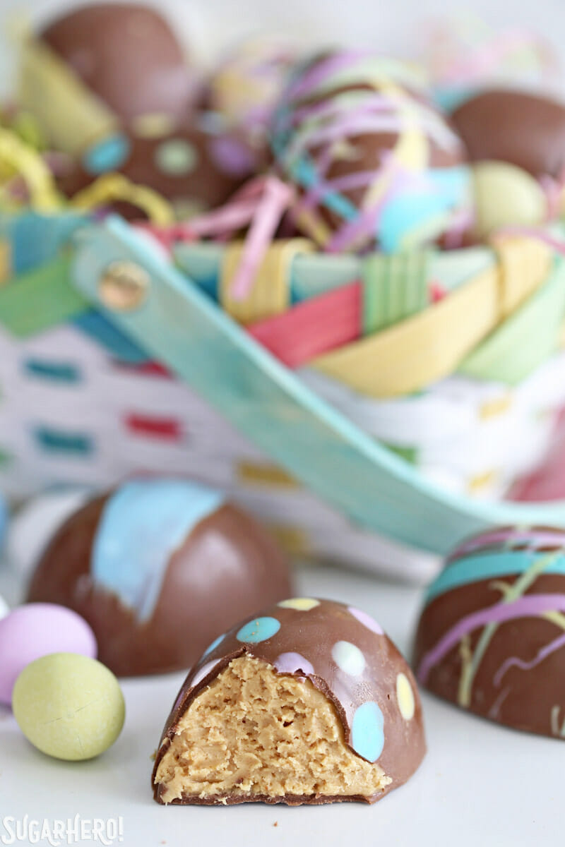 Peanut Butter Easter Eggs - close-up of peanut butter egg with a bite taken out of it | From SugarHero.com