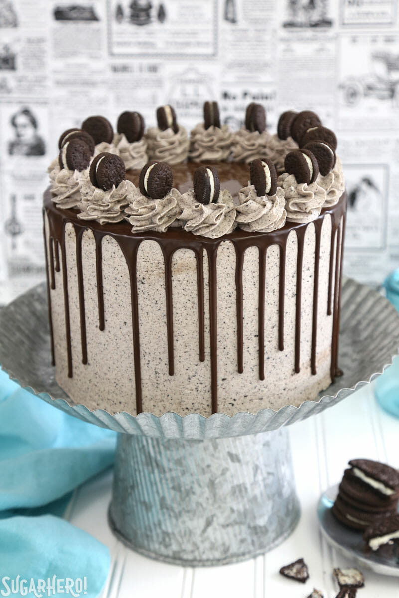 Cookies and Cream Cake - tall layer cake on a silver cake stand | From SugarHero.com