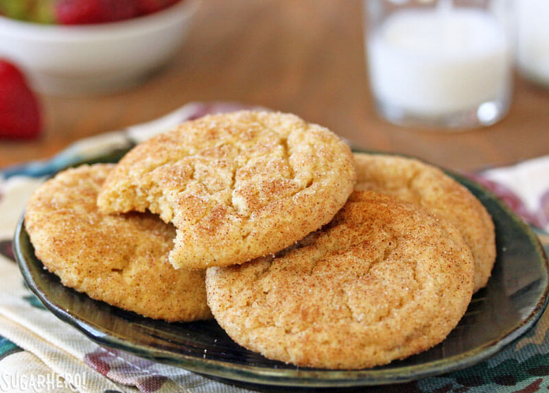 Snickerdoodle Cookies - a stack of cinnamon-coated snickerdoodles on a plate | From SugarHero.com