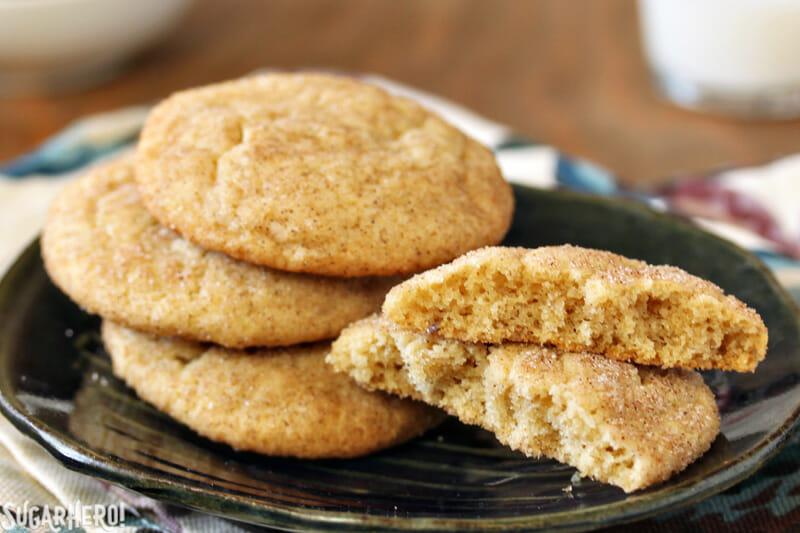 Snickerdoodle Cookies - close-up of snickerdoodle cookies with one broken in half | From SugarHero.com