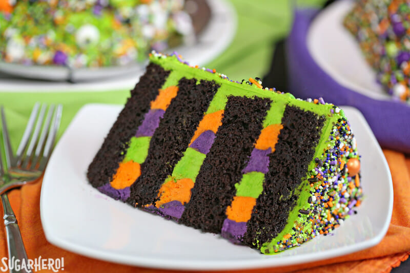 Monster Cake - close-up on a slice of Monster Cake on a plate | From SugarHero.com