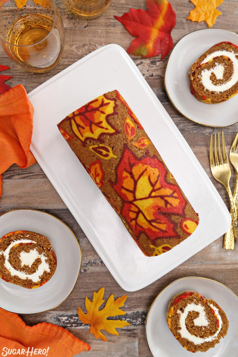 Patterned Pumpkin Roll - Overhead shot of the pumpkin roll with some slices taken out and displayed. | From SugarHero.com