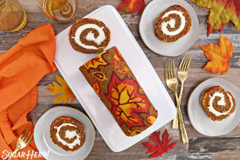 Patterned Pumpkin Roll - A over head shot of the pumpkin roll with some slices taken out. | From SugarHero.com
