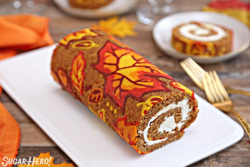 Patterned Pumpkin Roll - a shot of the pumpkin roll showing the piped designs. | From SugarHero.com
