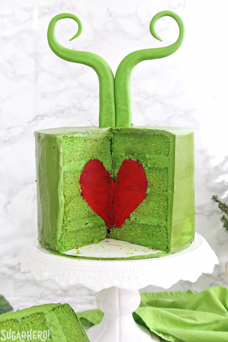 Grinch Cake - inside of the green Grinch cake, containing a bright red cake heart | From SugarHero.com