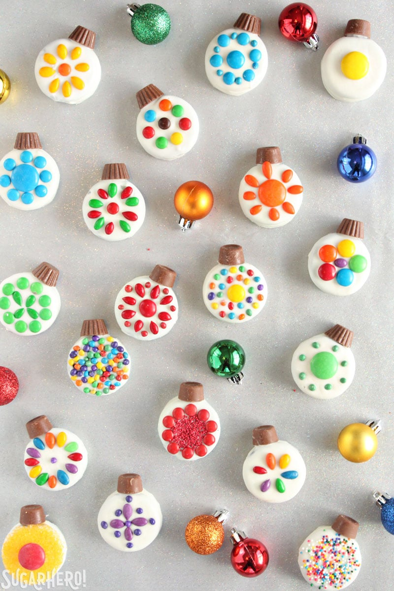 Oreo Cookie Christmas Ornaments - bright and colorful Christmas cookies arranged with ornaments around | From SugarHero.com