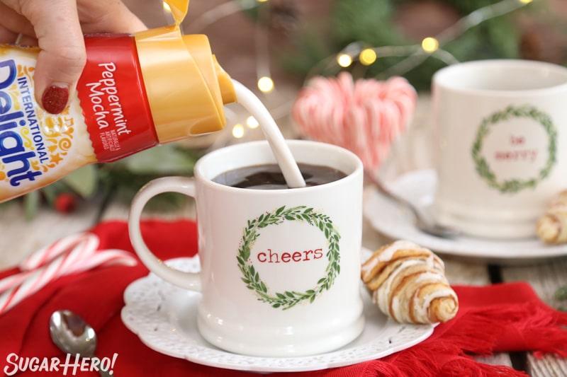 Peppermint Affogato - pouring creamer into a coffee mug | From SugarHero.com