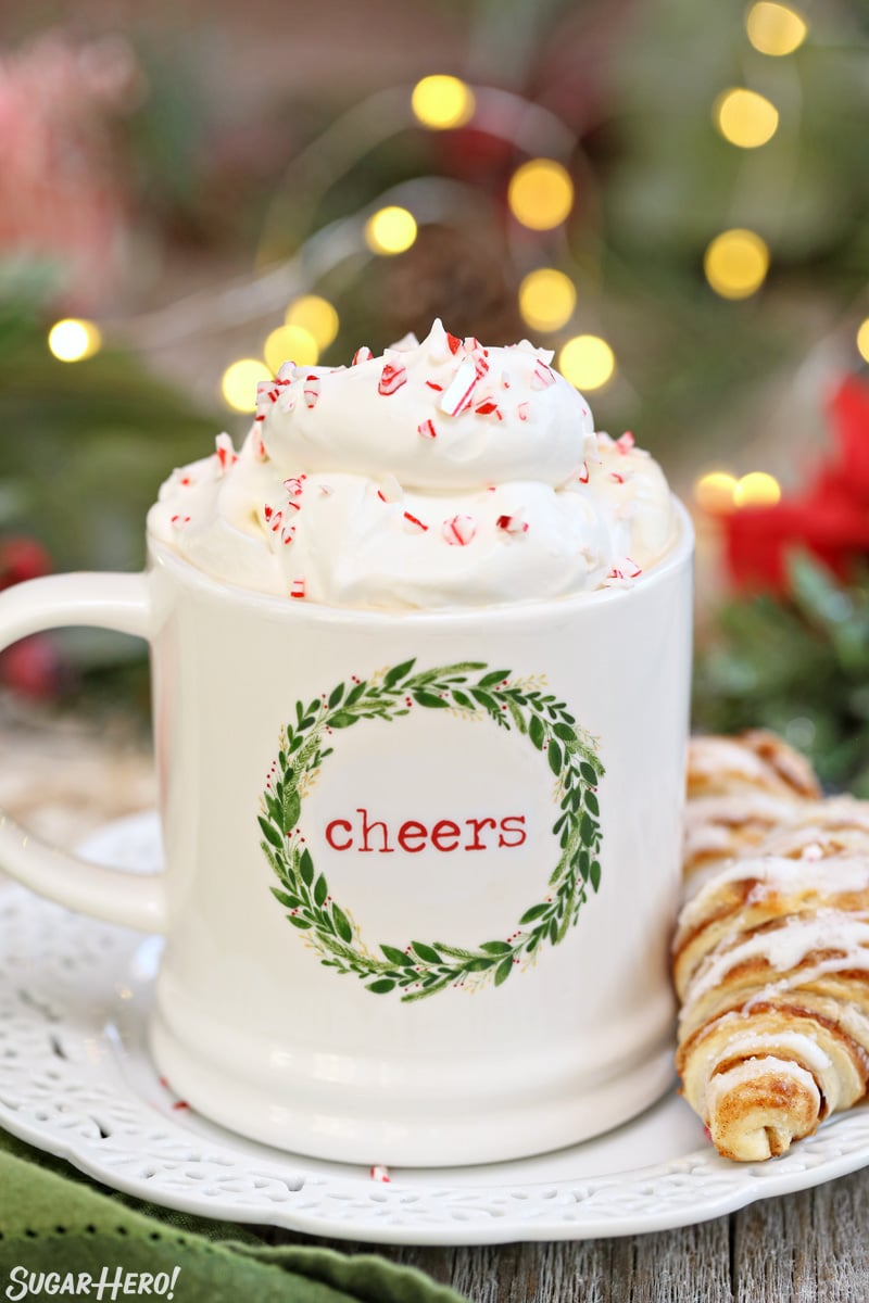 Peppermint Affogato - Christmas mug filled with coffee and topped with whipped cream and candy cane pieces | From SugarHero.com