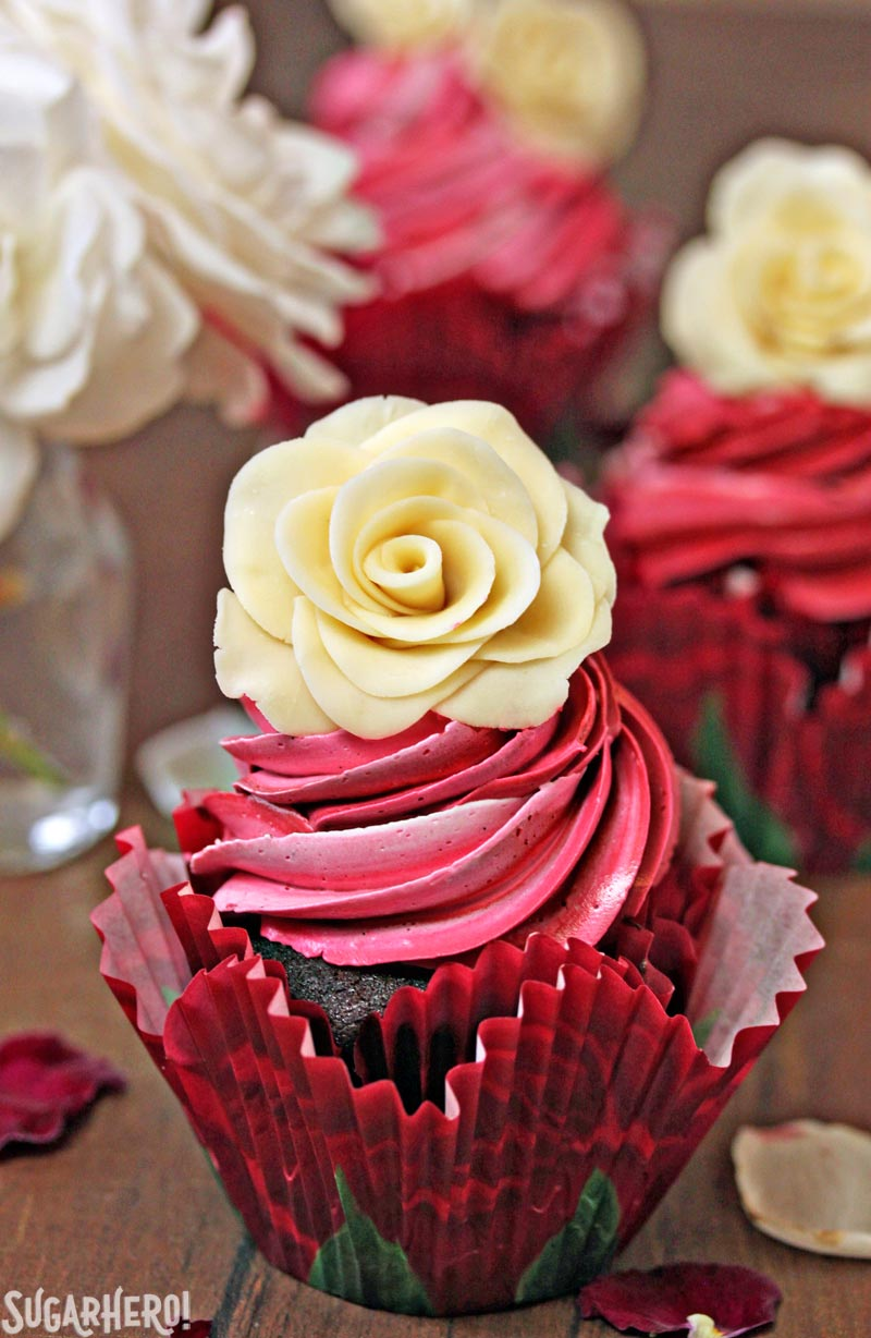 Chocolate Rose Cupcakes - A single chocolate cupcake with a white chocolate rose on top. | From SugarHero.com