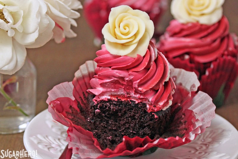 Chocolate Rose Cupcakes - A single cupcake with a bite taken out of it. | From SugarHero.com