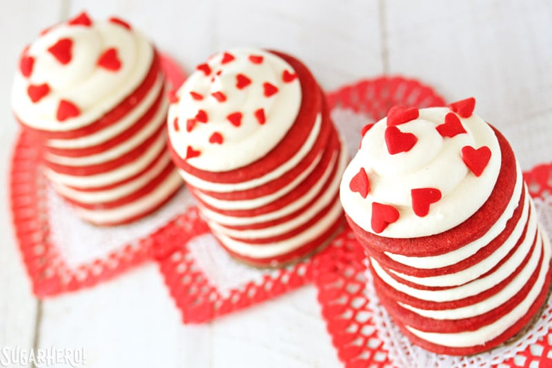 Red Velvet Icebox cakes - Three separate Icebox cakes with heart sprinkles on top | From SugarHero.com