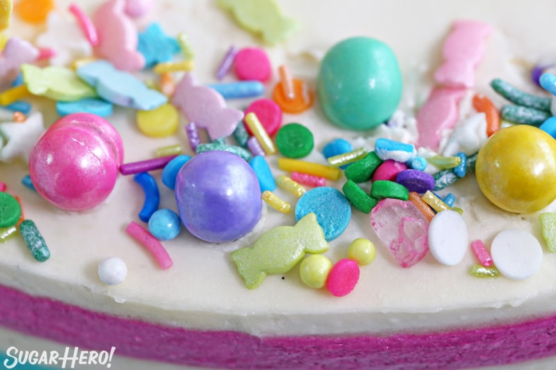 Striped Buttercream Balloon Cake - close-up of the sprinkle assortment on top of the cake | From SugarHero.com