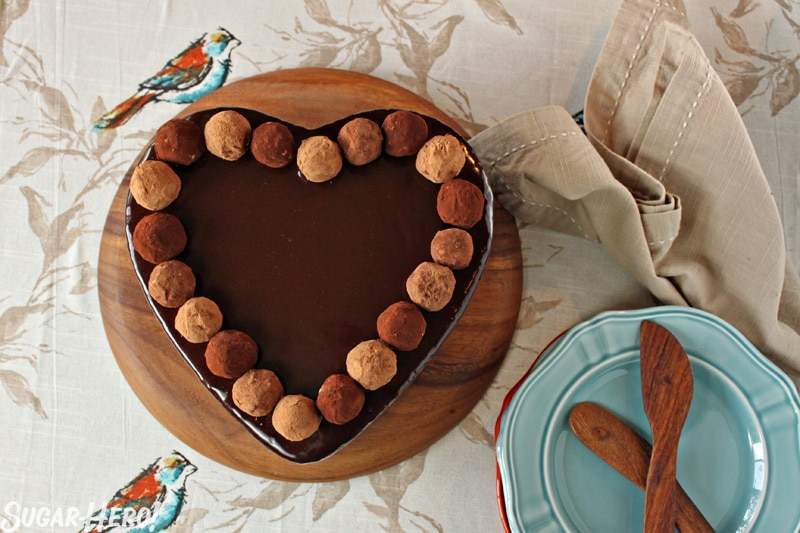 Truffle-Topped Heart Cake - Heart cake from the top view with the truffles lining the top. | From SugarHero.com
