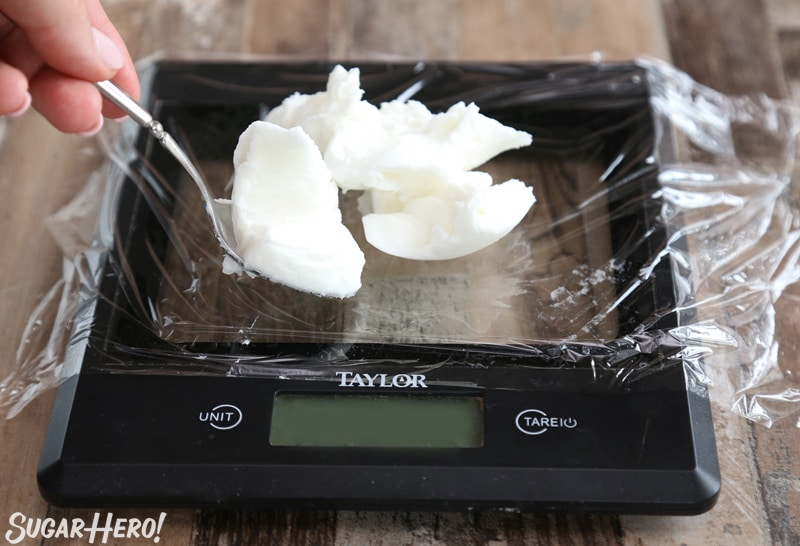 Spooning shortening onto a kitchen scale