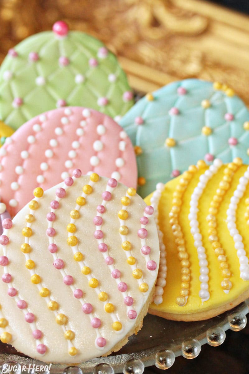 Stack of Easter egg sugar cookies with colorful sugar pearls and fondant decorations
