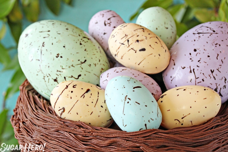 Easter Nest Cake - A close up of the eggs inside the nest. | From SugarHero.com