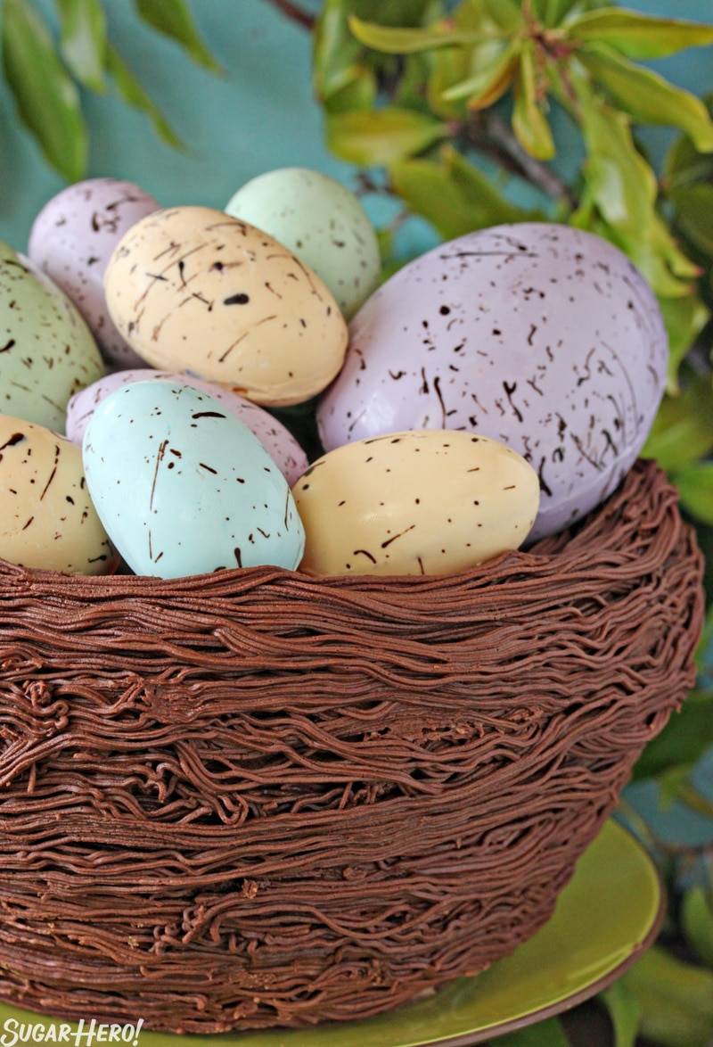 Easter Nest Cake - A close up of the nest cake, and eggs inside. | From SugarHero.com