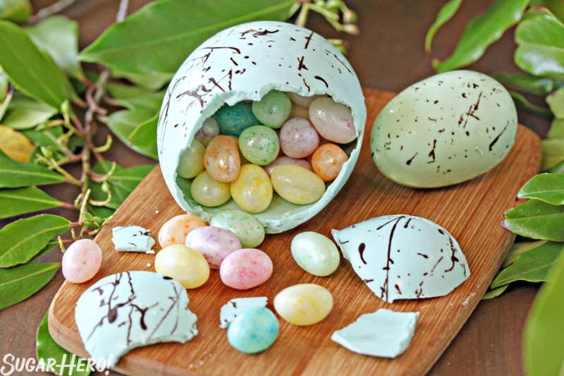 Easter Nest Cake - A close up of a candy egg cracked showing the candy inside. | From SugarHero.com