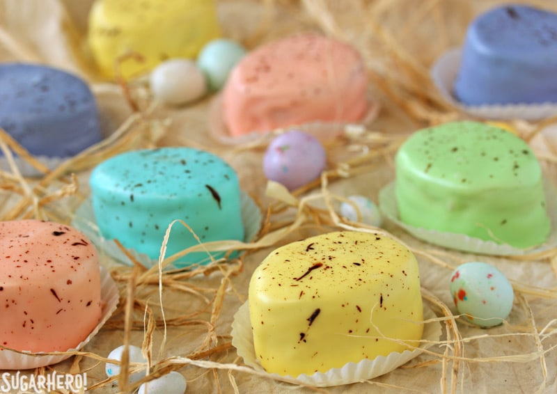 Easter Egg Petit Fours - group shot of petit fours in an assortment of pastel colors | From SugarHero.com